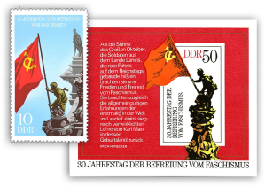 Two stamps of DDR showing the flag on German Parliament